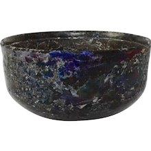 A Roman Iridescent Glass Bowl 1st-3rd Century AD