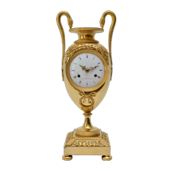 AN EMPIRE ORMOLU MANTEL CLOCK, EARLY 19TH CENTURY, FRANCE.