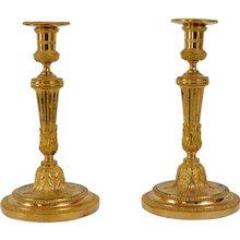 A Pair of Louis XVI Gilt Bronze Candlesticks.