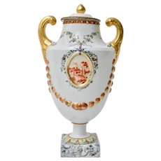 A Chinese Export Porcelain Pistol-Handled Famille Rose Urn, Jiaqing Period Circa 1800