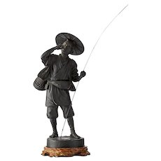 A Japanese Bronze Figure Of A Fisherman
