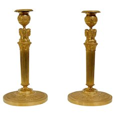 A Pair Of French Empire Gilt Bronze Candlesticks.