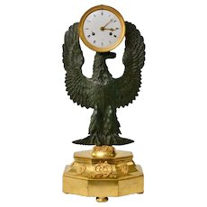 A French Gilt And Patinated Empire  Bronze Clock .
