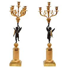 A Pair Of French Gilt And Patinated Empire Candelabra, Early 19th Century.