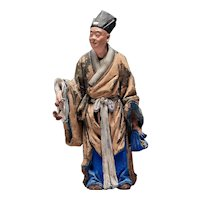 Chinese Sculptured And Painted Clay Figure Of A Standing Man Holding A Lingzhi Mushroom. 19th Century