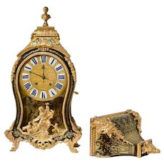A Louis XV Ormolu-Mounted, Brass-Inlaid, Tortoiseshell And Boulle Maquetry Striking Bracket Clock, Signed Jean Bacquet, Paris.