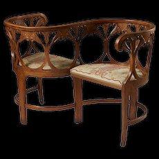 Tête a Tête sofa designed by Alf Wallander for Giöbbel's workshop,  Sweden. 1900.