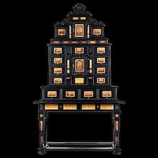 An Augsburg pietre dure inlaid and pietre paesine cabinet on stand