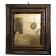Franco-Flemish ebonized kingwood mirror.