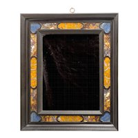 An 19th century Florentine ebony and ebonised lapis lazuli inlaid mirror