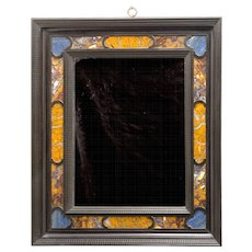 An 19th century Florentine ebony and ebonised lapis lazuli inlaid mirror