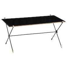 Coffee table in the style of Jacques Adnet