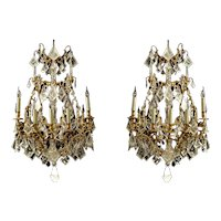 A pair of French 19th Century 16 armed large gilded bronze and rock crystal chandeliers