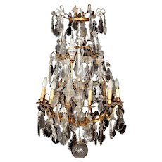 An exquisite 18th century French bronze and crystal chandelier