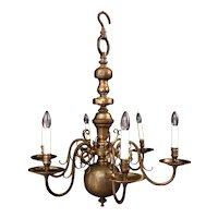 A six arm Dutch style brass chandelier