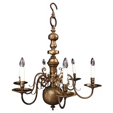A six arm Dutch style brass chandelier
