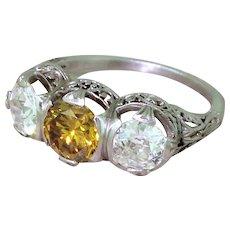 Art Deco 2.10 Carat Fancy Intense Yellow & White Diamond Trilogy Ring, circa 1925