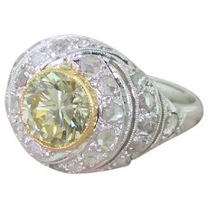 Retro 1.66 Carat Fancy Light Greenish Yellow Transitional Cut Bombé Ring, circa 1945