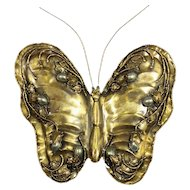 a butterfly brass bronze sconce circa 1960