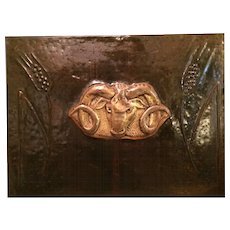 A large French Art Deco embossed large plaque bronzed metal panel