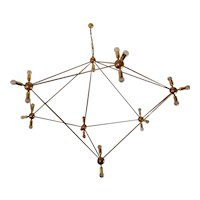 an asymmetrical pentagonal abstract shaped  gigantic chandelier  ,made of solid brass ,in bronze finish