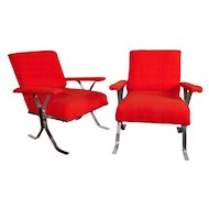 A mid century pair of steel and wood lounge chairs