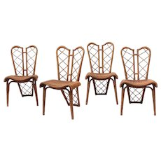 "Jean Royere set of 4 ""papillon"" chairs"