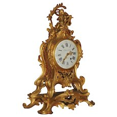 19 th Century Clock  in bronze Louis XV Style signed Le Faucheux.