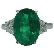 Platinum Oval Emerald and Diamond Ring