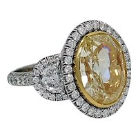 7.06 Carat Fancy Intense  Yellow Oval Diamond Gold Platinum Ring