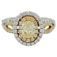 18K Yellow and White Oval Fancy Intense Yellow Diamond Two Color Gold Ring