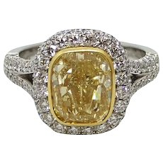 4.00 Carat Fancy Yellow Cushion Cut Diamond Platinum and Gold Ring