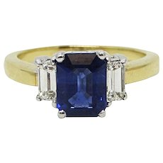 2.15 Carat Emerald Cut Sapphire Yellow and White Gold Ring