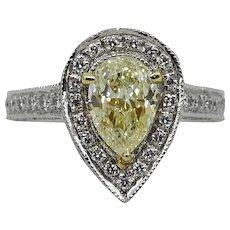 Platinum Light Yellow Pear Shaped Diamond and Round Diamond Ring