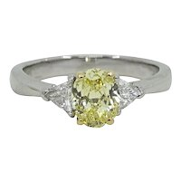 Oval Brilliant Fancy Intense Yellow Diamond Platinum White Gold Ring