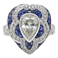 Platinum 1.34 Pear Shaped Diamond and Calibre Sapphire Ring
