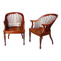 A Pair of Edwardian Walnut Club Chairs