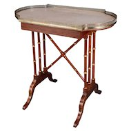 JOHN McLEAN: A Rosewood, Parcel-Gilt, Brass-Mounted and Marble Topped 'Pouch' Table