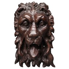 An Elizabeth I Carved Oak Lion Mask Mount