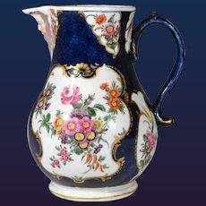 First Period Worcester Porcelain Large Blue Scale Botanical Mask Jug, Circa 1765.