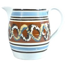 Mocha Pearlware Jug with Double Earthworm Design,  Circa 1800-30.