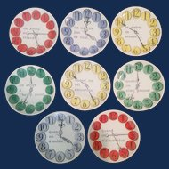 "Piero Fornasetti Set of Eight ""Quand on Arrive"" Clock Coasters, ""When one arrives"", early 1960s."