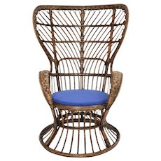 High Wingback Rattan Chair by Lio Carminati circa 1948 and executed by Bonacina Italy