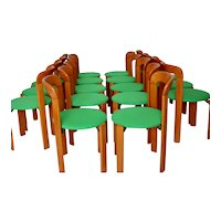 Up to 24 Green Honey colored Vintage Stacking Chairs by Bruno Rey 1970s