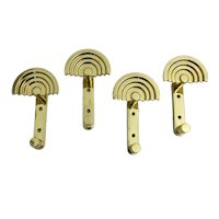 Set of four Quattro SE 314 Brass Coat Hooks by Ettore Sottsass Italy circa 1985