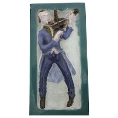 Colored glaze ceramic Tile Fiddler by Michael Powolny circa 1925