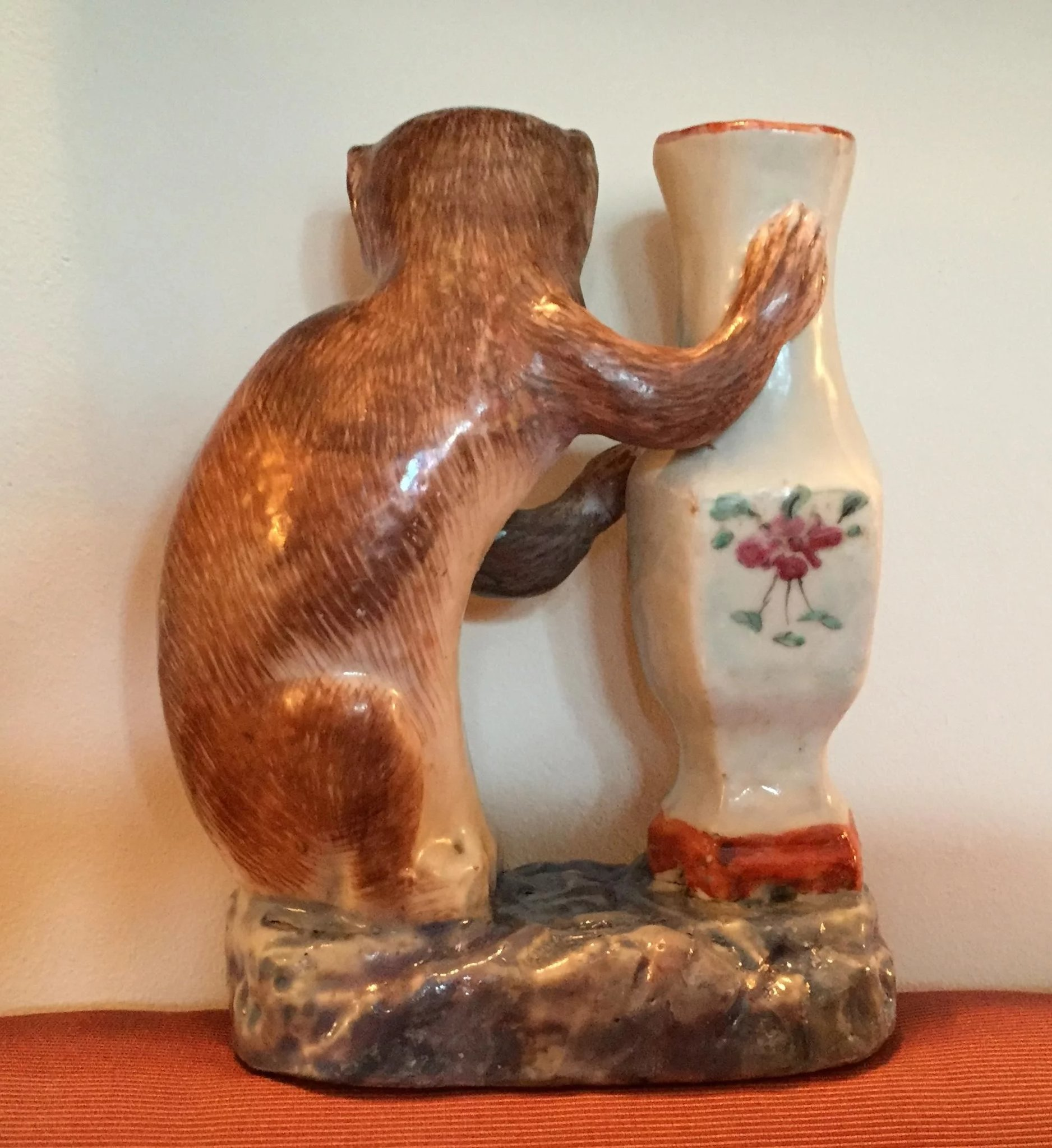 Chinese Porcelain Monkey Grasping A Famille Rose Vase