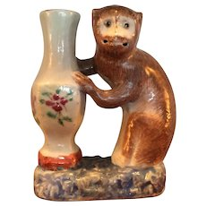 Chinese Porcelain Monkey Grasping a Famille Rose Vase Qianlong Period 18th century