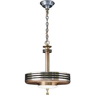 1930's Circular pendant made from stacked disks and white glass.
