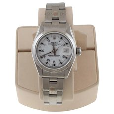 Pre-Owned 1991 Ladies Stainless Steel Date Watch With White Roman Dial And Smooth Bezel With Oyster Band Model# 69160   PRICE - $2500.00